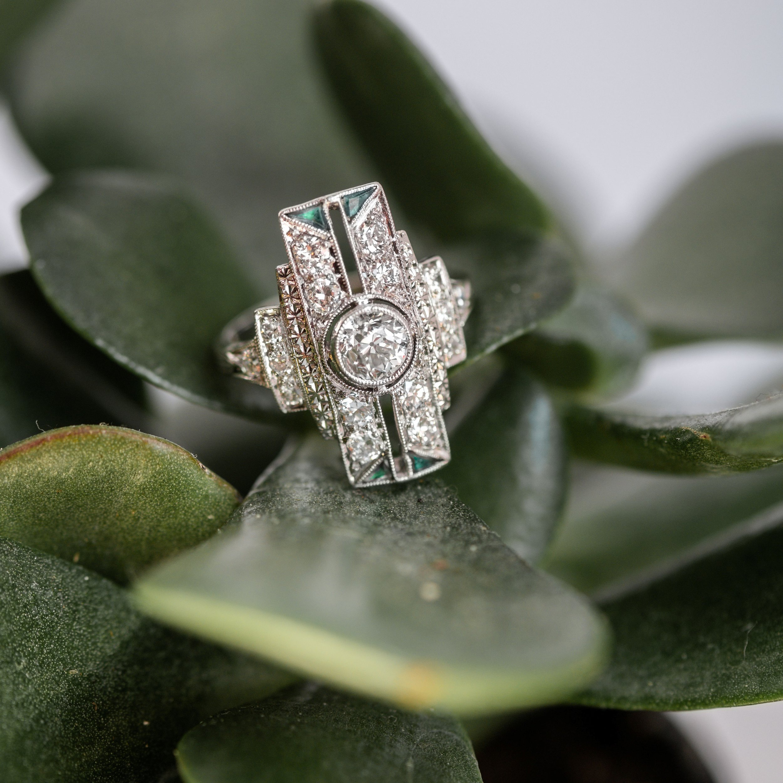 We're swooning over this Art Deco diamond and platinum ring that has just the right amount of deep, rich green! Shop this beauty  HERE .