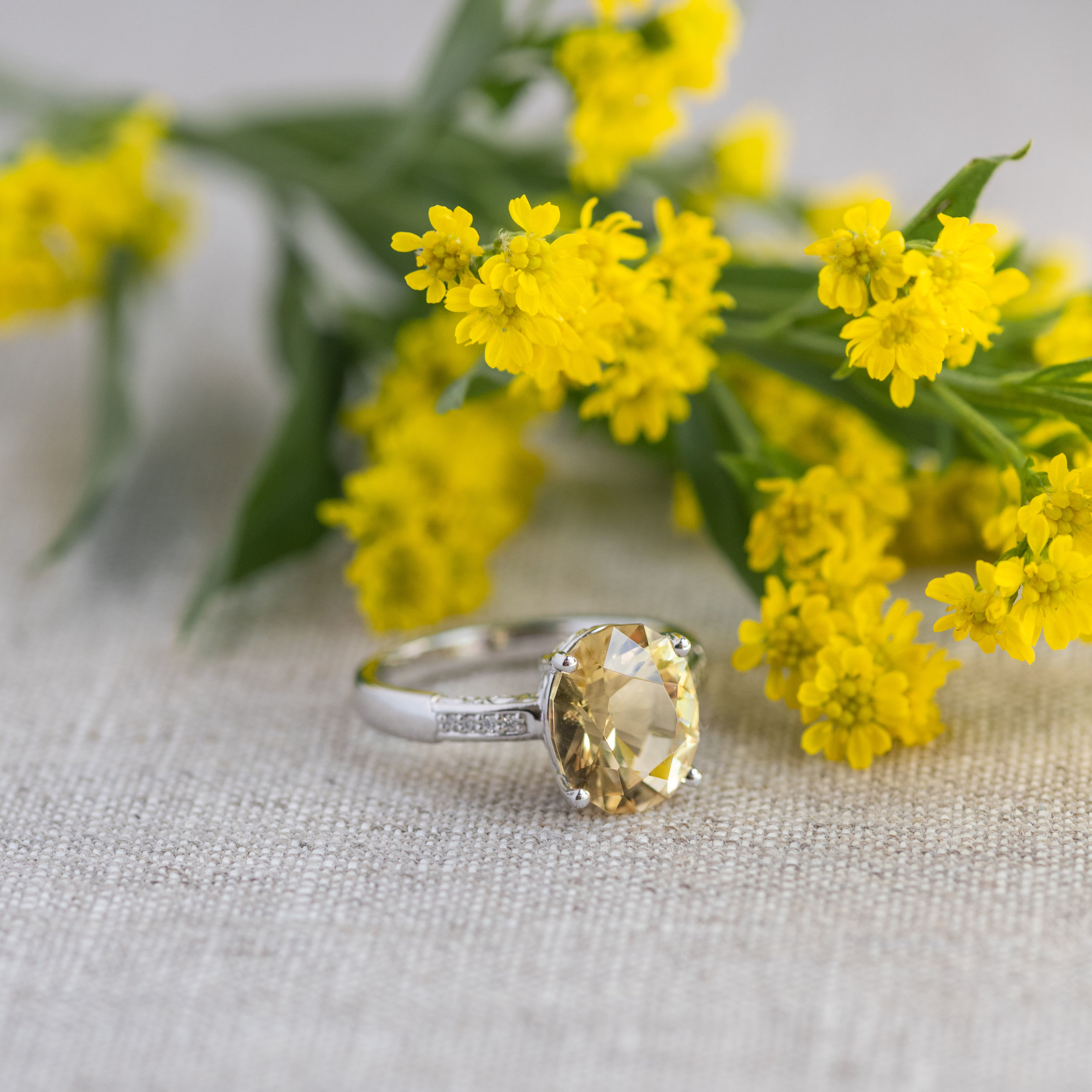 For all of our faithful followers and gem lovers- you may think you're looking at a Citrine. But, this exotic gemstone is actually a Scapolite! Yellow like honey with a glass-like luster that makes it easy to love 🍯 Shop this ring  HERE !