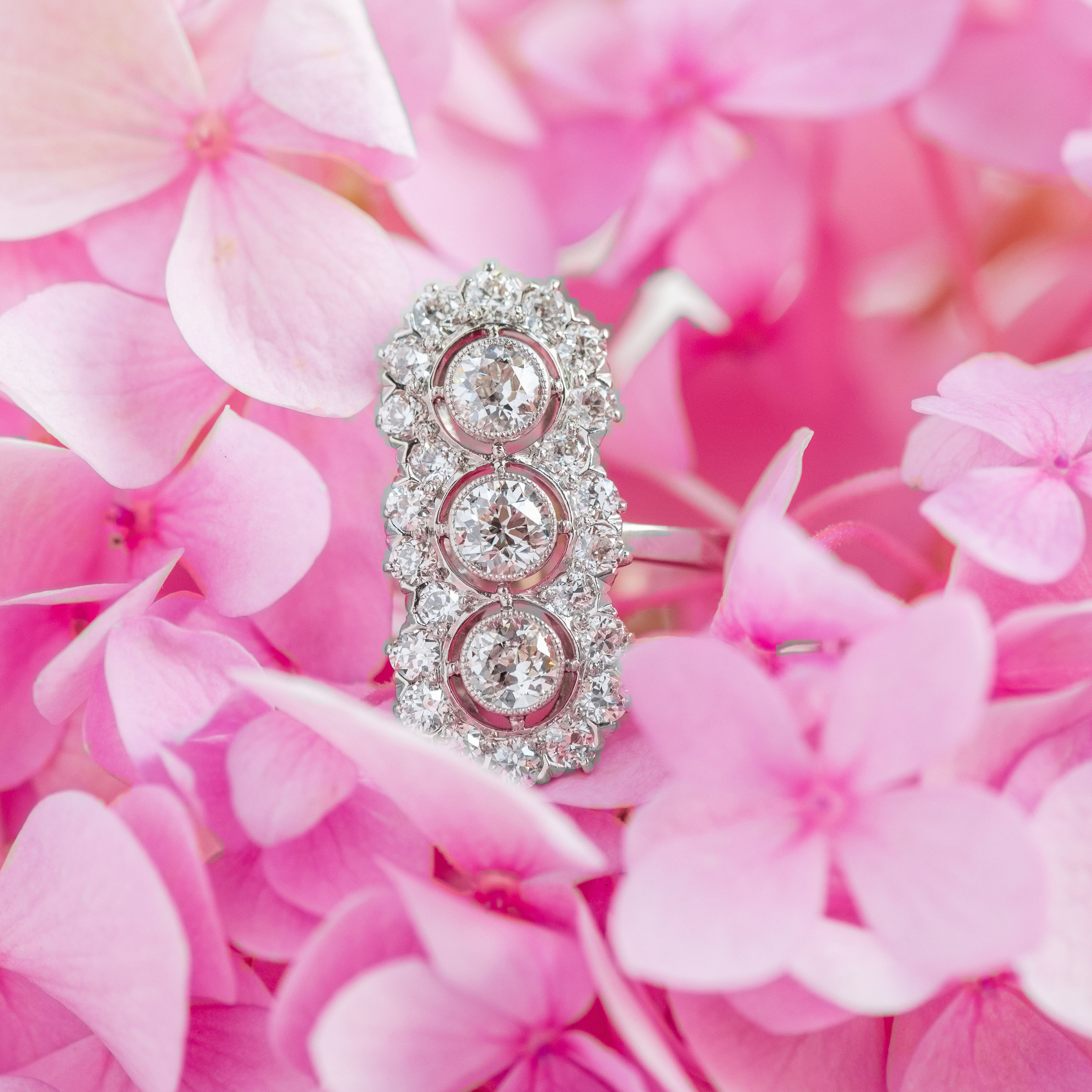 This Art Deco beauty features 1.78 carats of Old European cut diamonds in a light an airy elongated platinum setting. Shop this piece of perfection  HERE .