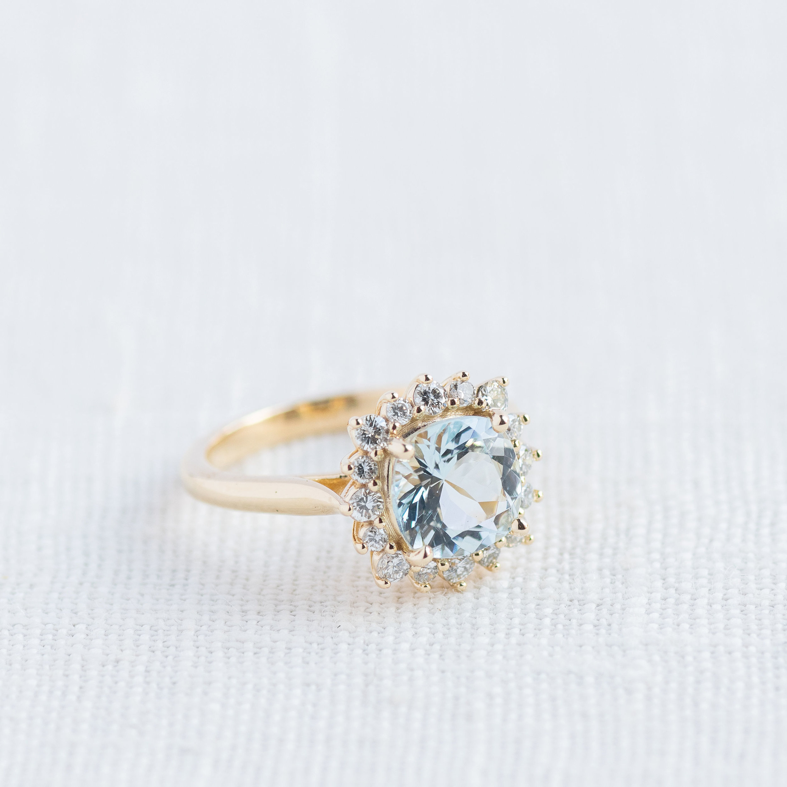Cool off from the summer heat with this refreshing 1.95 carat aquamarine ring surrounded by diamonds! Click  HERE  to shop!