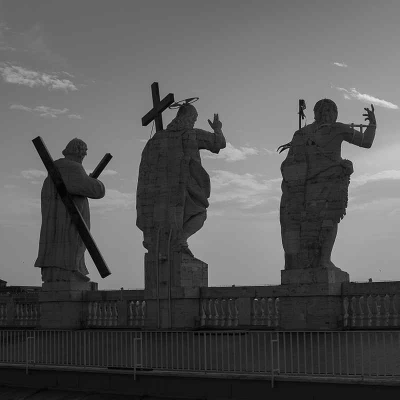 statues_at_the_top_of_st_peters_basilica.jpg