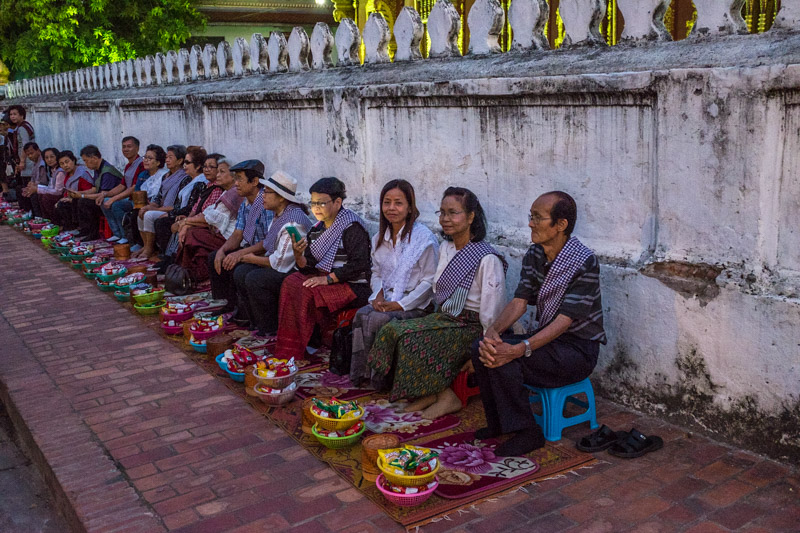 asian_tourists_line_the_street_alms_giving_cermony_luang_prabang.jpg