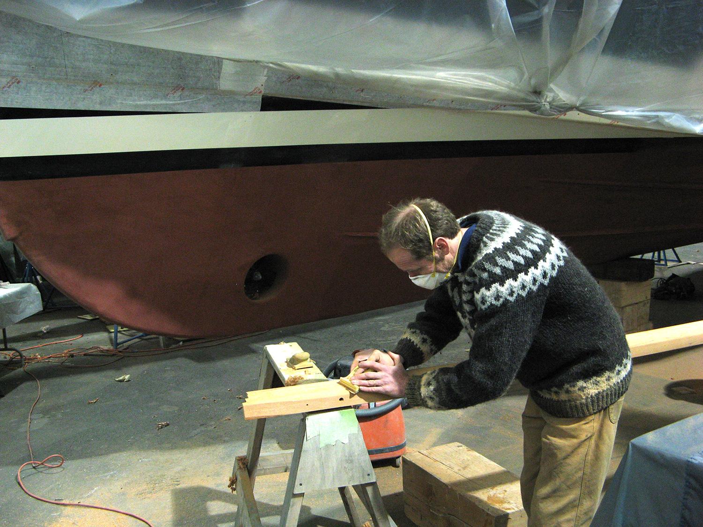 Carefully shaping the mahogany.