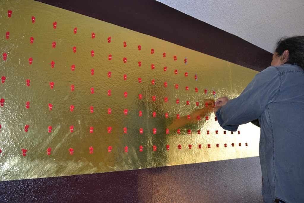 Prayer Painting Attaching More Prayers.jpg