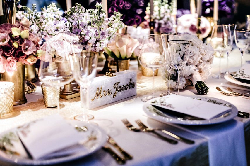 Table Numbers - If you're commissioning escort cards, you'll need to mark each table with a table number or title so that guests can match up their escort card to where they will be sitting.
