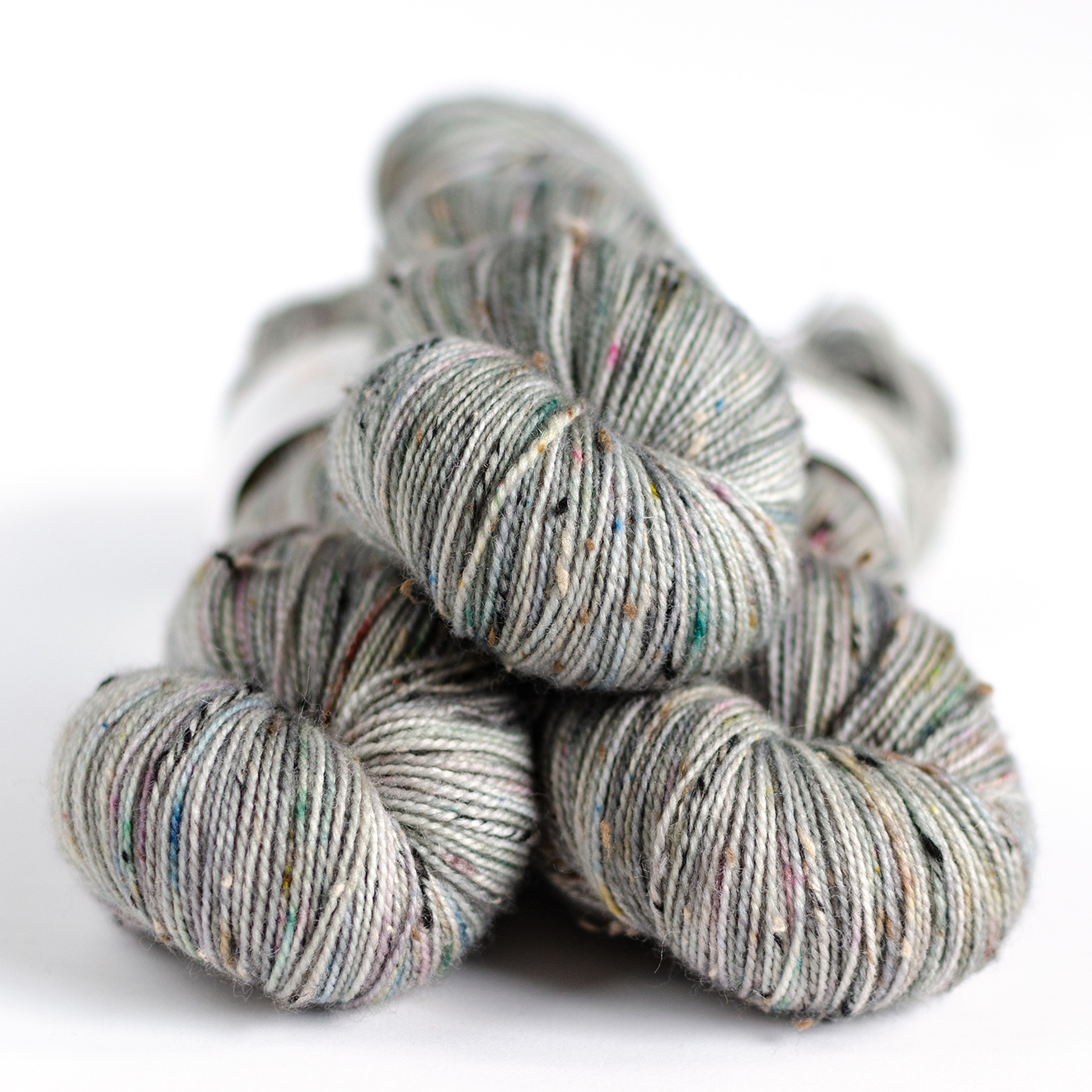 BFL Tweed - $25  85% British BFL, 15% NEP (nylon)  2 plies  435 yards / 398 meters  100 grams  Fingering Weight  US 1-5 / 2.25-3.75mm  Hand wash / Dry flat  This highly textural base has neutral colored tweedy slubs spun into the two plies.