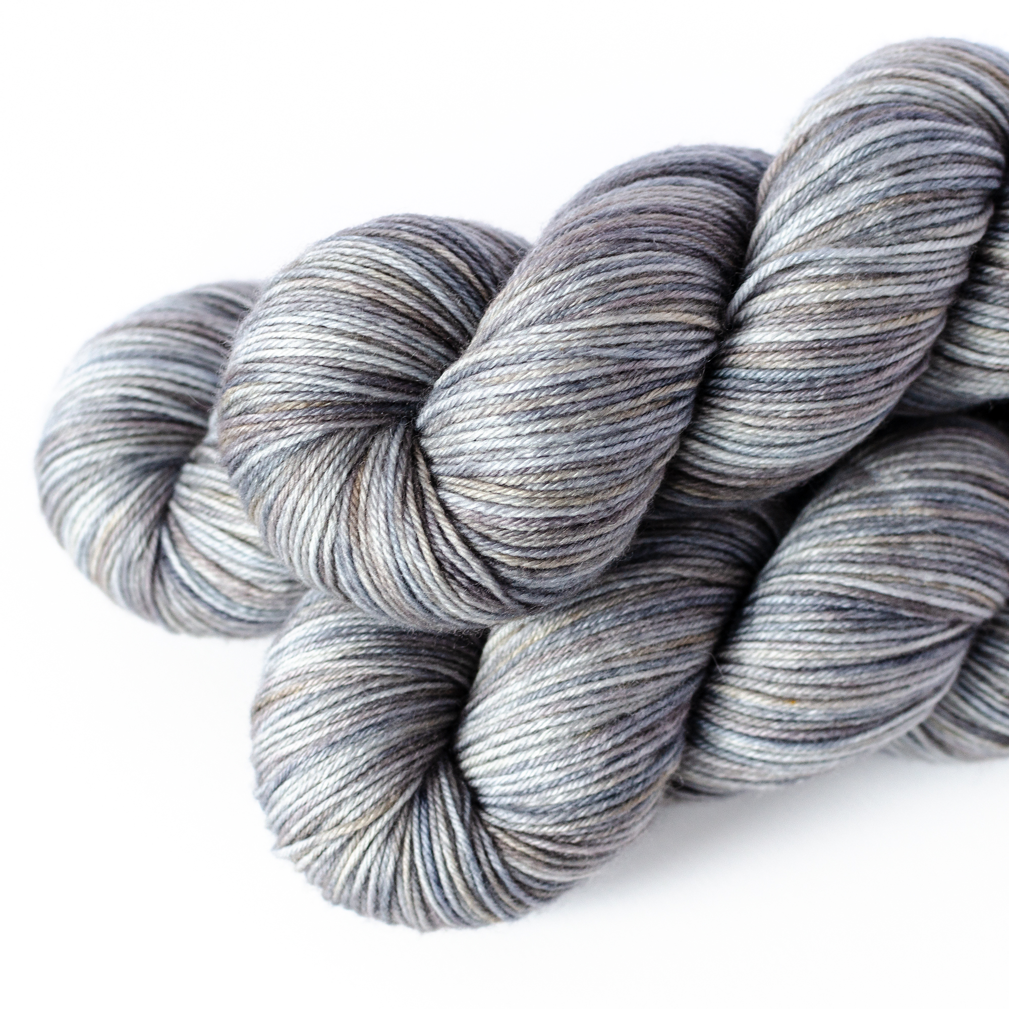 MCN Sock - $29  80% SW Merino, 10% Cashmere, 10% Nylon  4 plies  435 yards / 398 meters  100 grams  Fingering Weight  US 1-5 / 2.25-3.75mm  Hand wash / Dry flat  This yarn is soft, smooth, and lofty.
