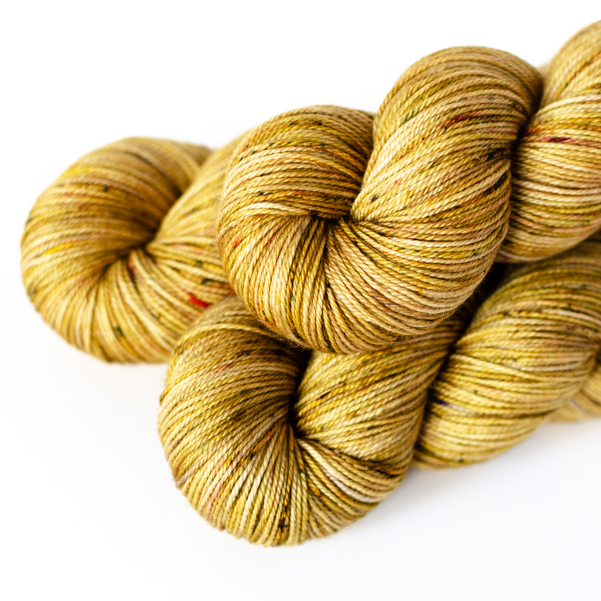 MCS Sport - $30  75% SW Merino, 15% Cashmere, 10% Silk  3 plies  396 yards / 362 meters  115 grams  Heavy Fingering - Sport Weight  US 1-6 / 2.25-4mm  Hand wash / Dry flat  This base falls between fingering and sport. It's is soft and smooth and a good amount of drape.