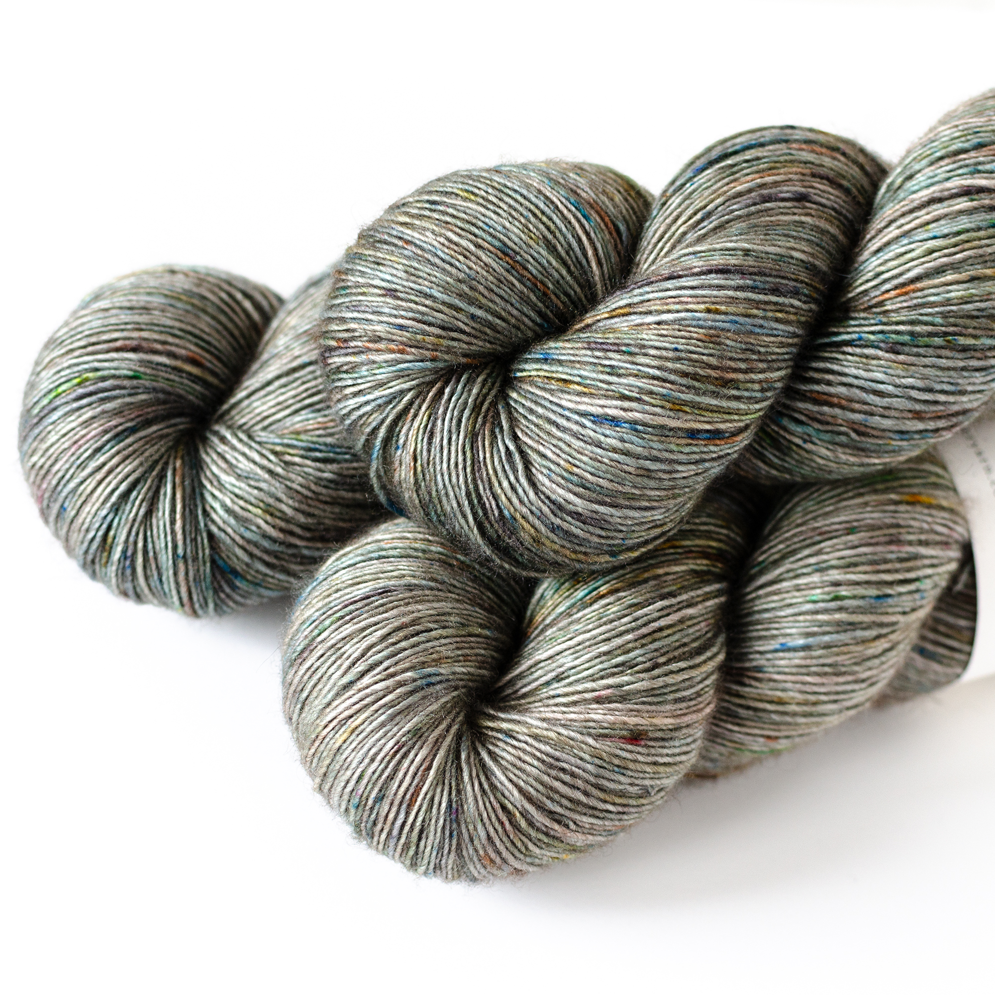 Vesper- $32  65% SW Merino, 20% Silk, 15% Yak  unplied  520 yards / 475 meters  120 grams  Fingering Weight  US 1-5 / 2.25-3.75mm  Hand wash / Dry flat  Undyed, this base is a brown/grey color. It's a smooth, soft, single ply yarn that has drape and shine from the silk content. Skeins are a large 120 grams.