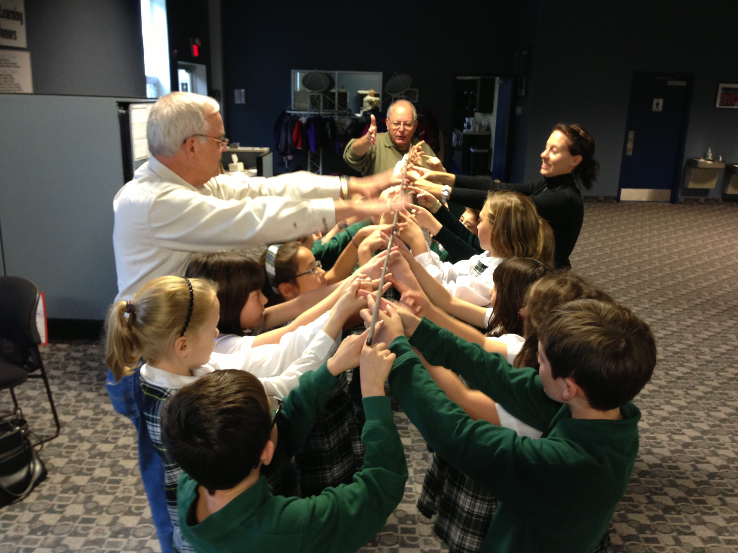 Our popular team-building helium stick exercise teaches students to work together.