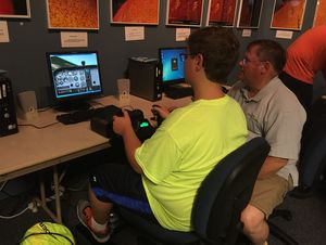 A student learns on a newly installed flight simulator at the Dresser-Rand Challenger Learning Center in Allegany during its inaugural Summer Aviation Camp last week.