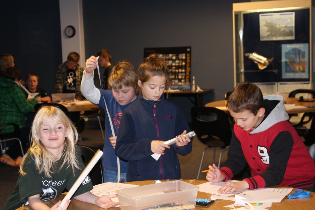 A team from Pioneer working on their rocket.