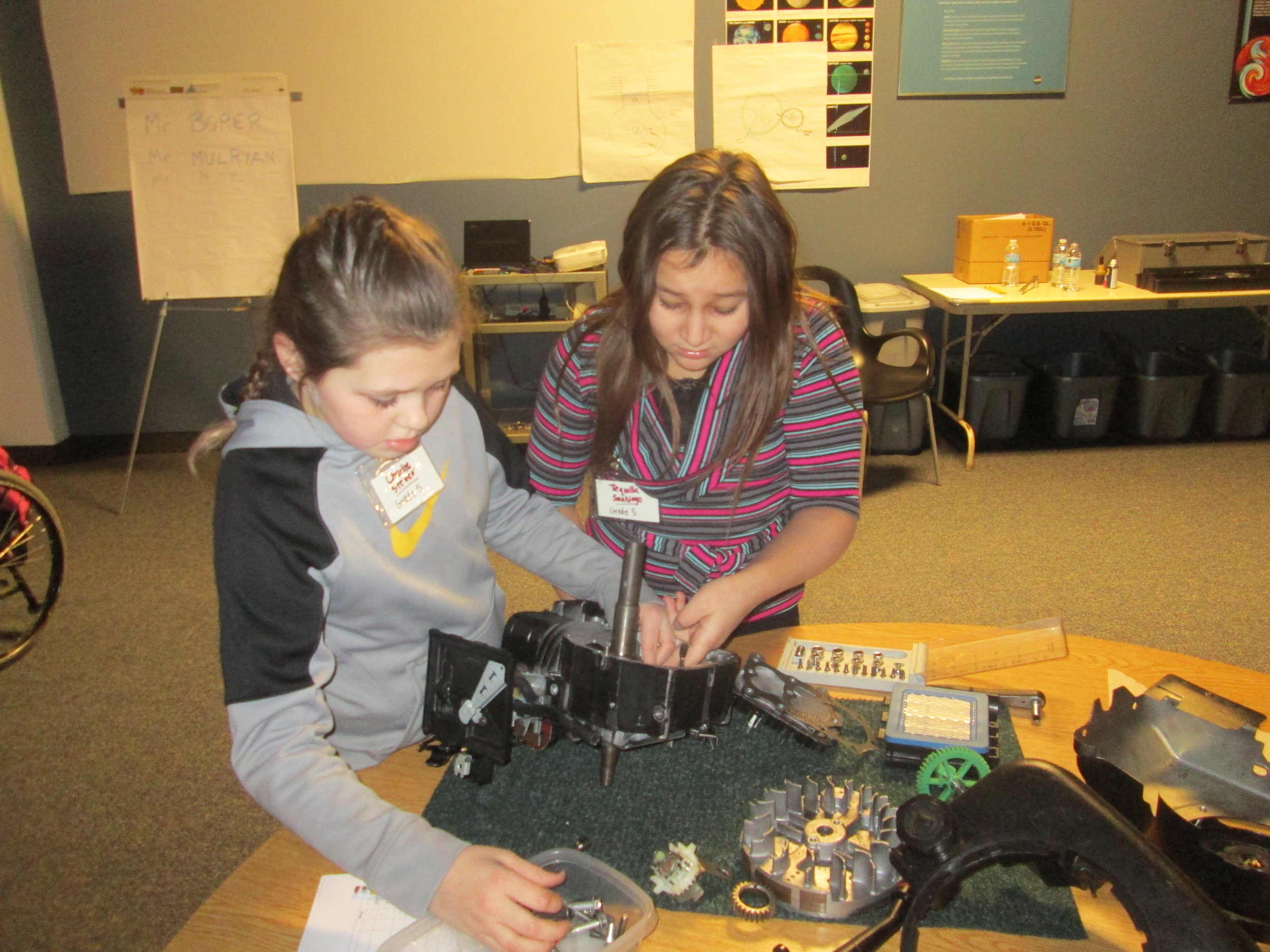 Students from Canisteo-Greenwood after school program working on their engine.