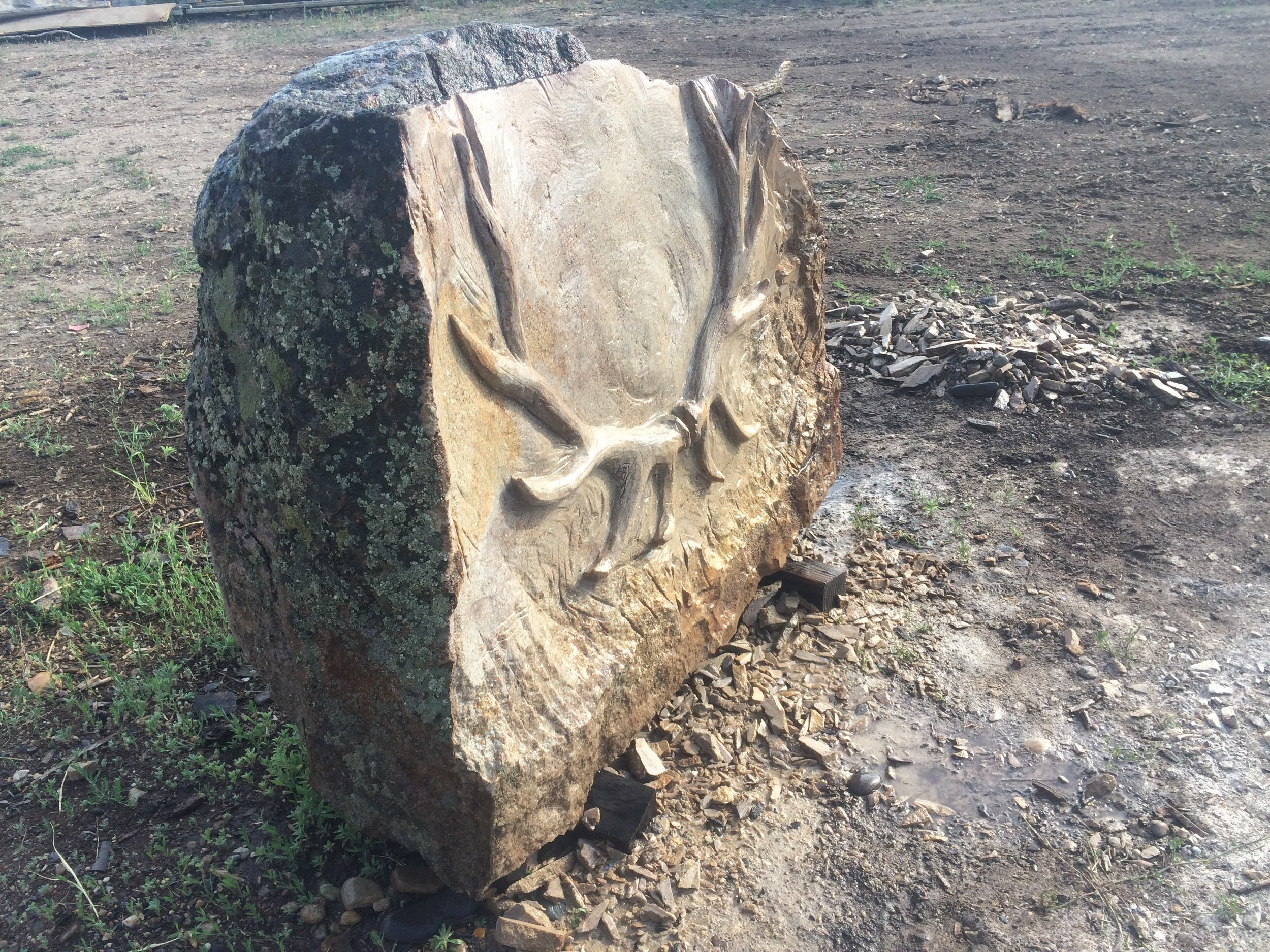 CHris sculpted an elk rack out of this beautiful sandstone / granite rock for a client's family memorial headstone.