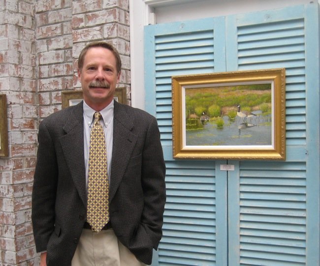 William R. Beebe standing next to the painting voted best in show,   Standing Guard  , 12 x 18, oil on board.