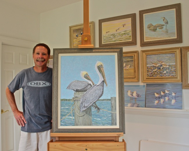 William R. Beebe with   Feathered Friends   painting and others in studio