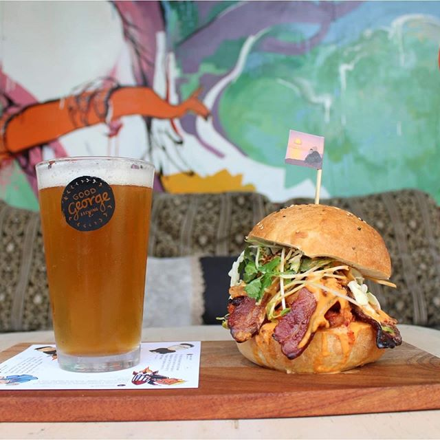 Introducing our KIM JONG SUPREME BURGER - APA brined Korean spiced chicken thigh, miso maple bacon, kimchi, coriander slaw, sesame & sriracha aioli, cascade hop salted shallots on a bread asylum baked bun.  Matched with @goodgeorgebeer APA  Sounds pretty good right, come in - try it for yourself then vote as we are entered in the moo & brew beer and burger match competition  #BeerAndBurgerMatch