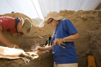 Larry Largent and Shelby White excavating a Bronze Age burial
