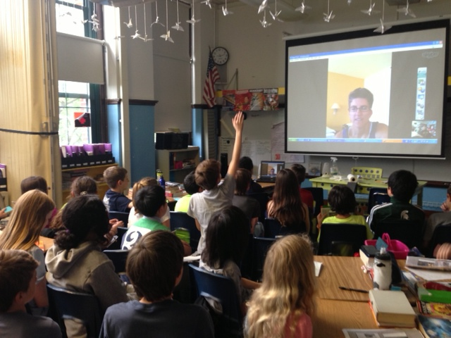 A class of 5th graders Skyping with archaeologist Tracy.
