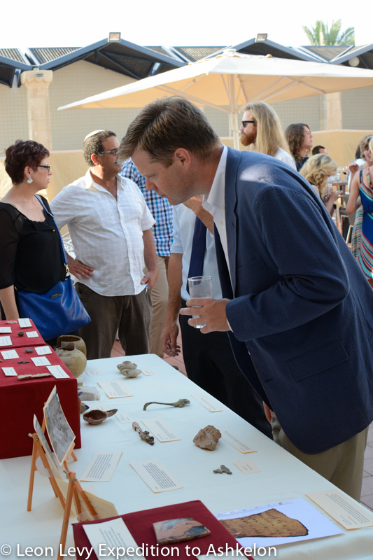 Co-Director Daniel Master examines some of the finds of the season