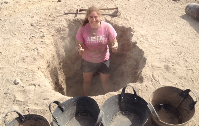 Emily stands in the hole she dug. Today