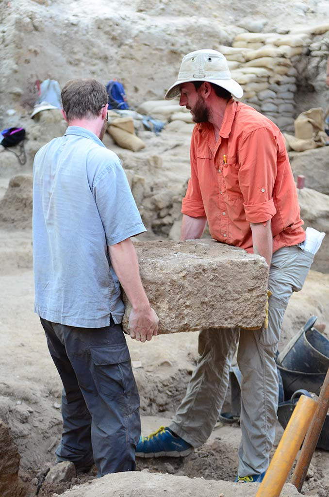 Co-Grid Supervisor Jonathan Wylie and Ben move a big stone