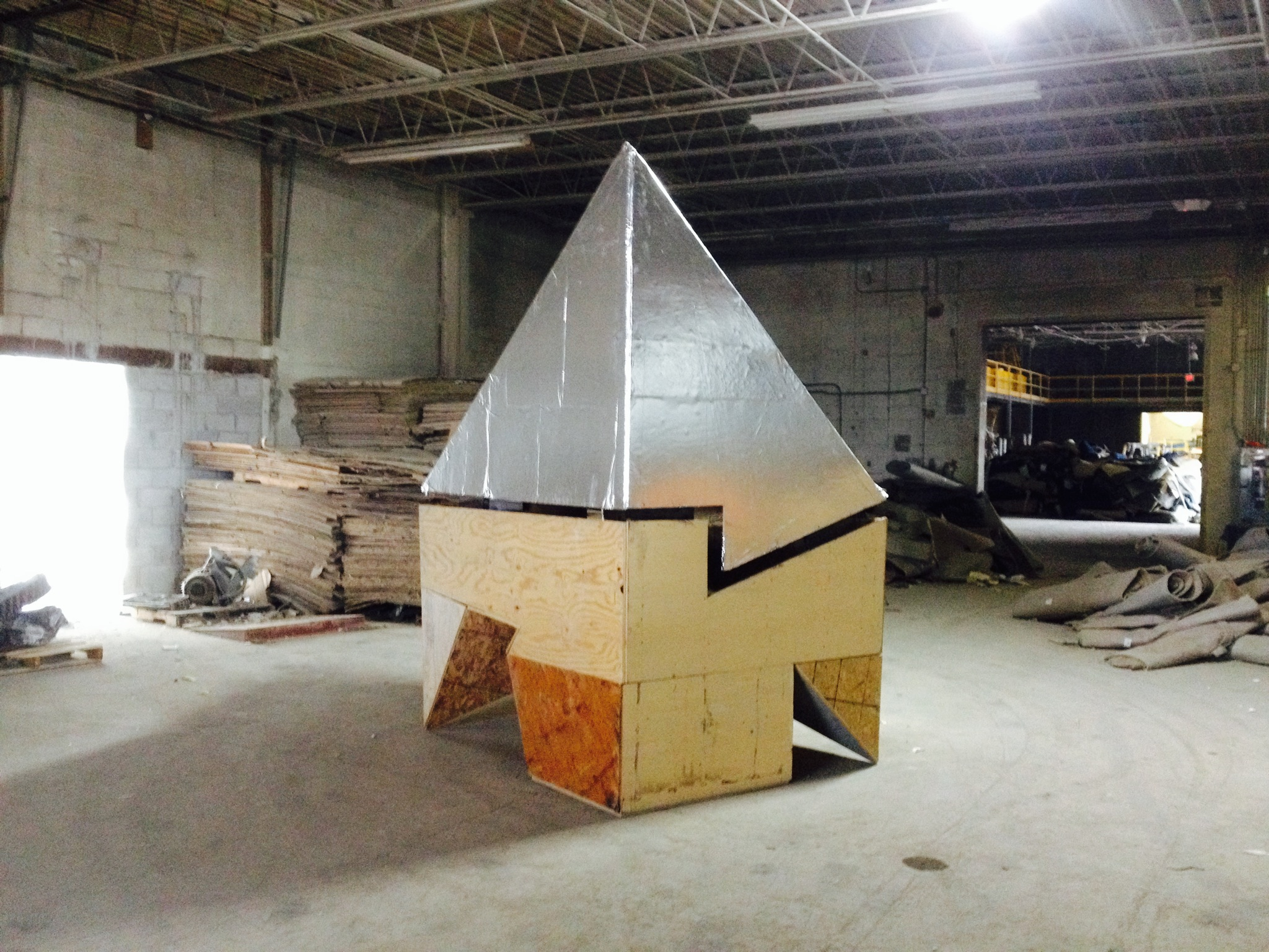 """Architect Simon Kim and artist Billy Dufala produced the first of three projects through RAIR. Kim and Dufala have collaborated in the past and continued their conversation for this first residency by asking the question: """"What are discerning elements of citizenship, governance, and identification in a city made of pieces of past colonial powers?"""" They constructed a house for the Minister of Foreign Affairs of SURA – an imagined amalgamation of Paris, London, and Tokyo neighborhoods. The building, fabricated and demolished within thirty-six hours on site at RAIR, existed within the ICA gallery via documentation.       Ministers of Foreign Affairs    Ibañez Kim Studio     ICA 50: exhibition"""