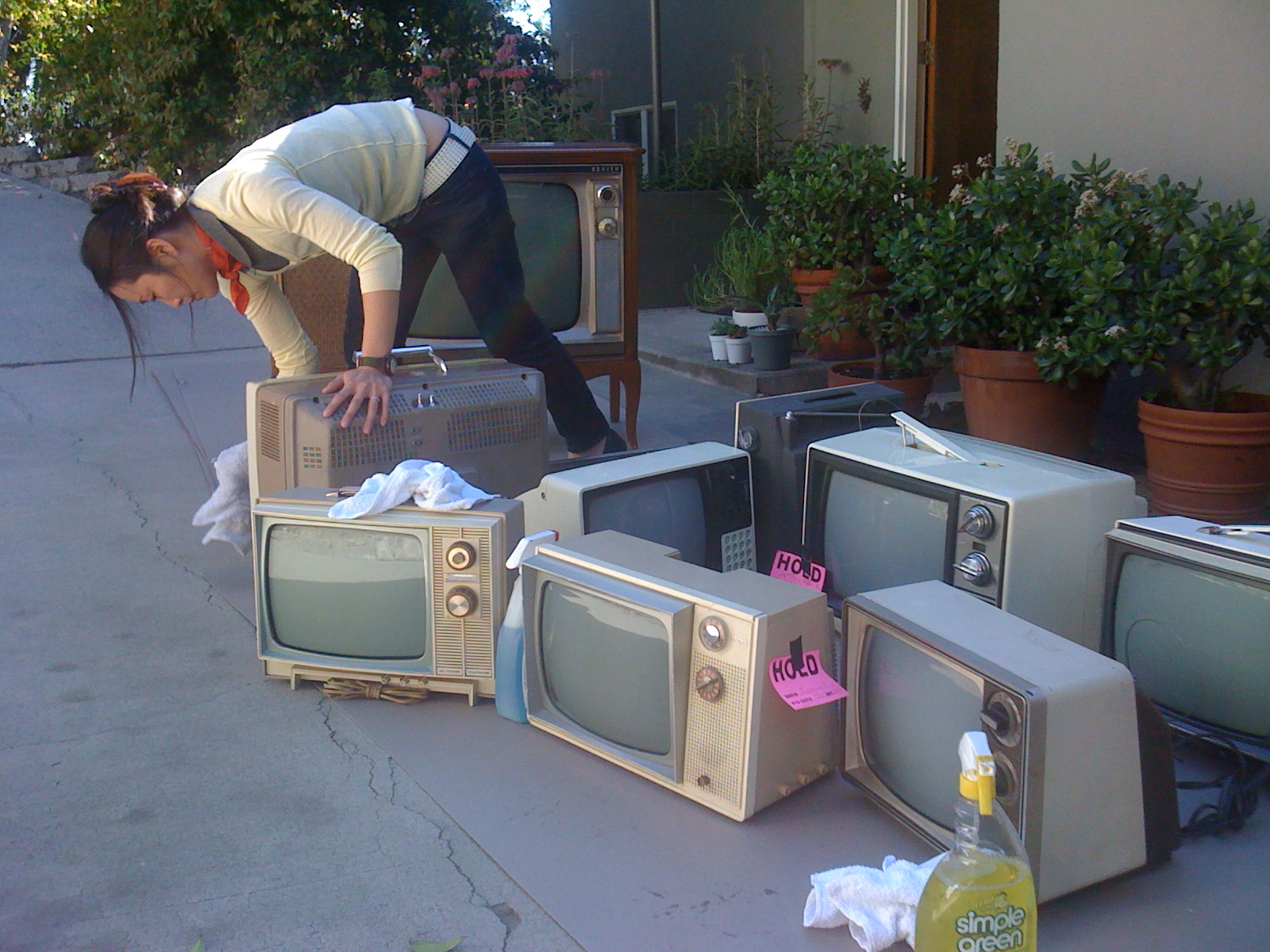 Jenny prepares the vintage televisions for their close-ups.