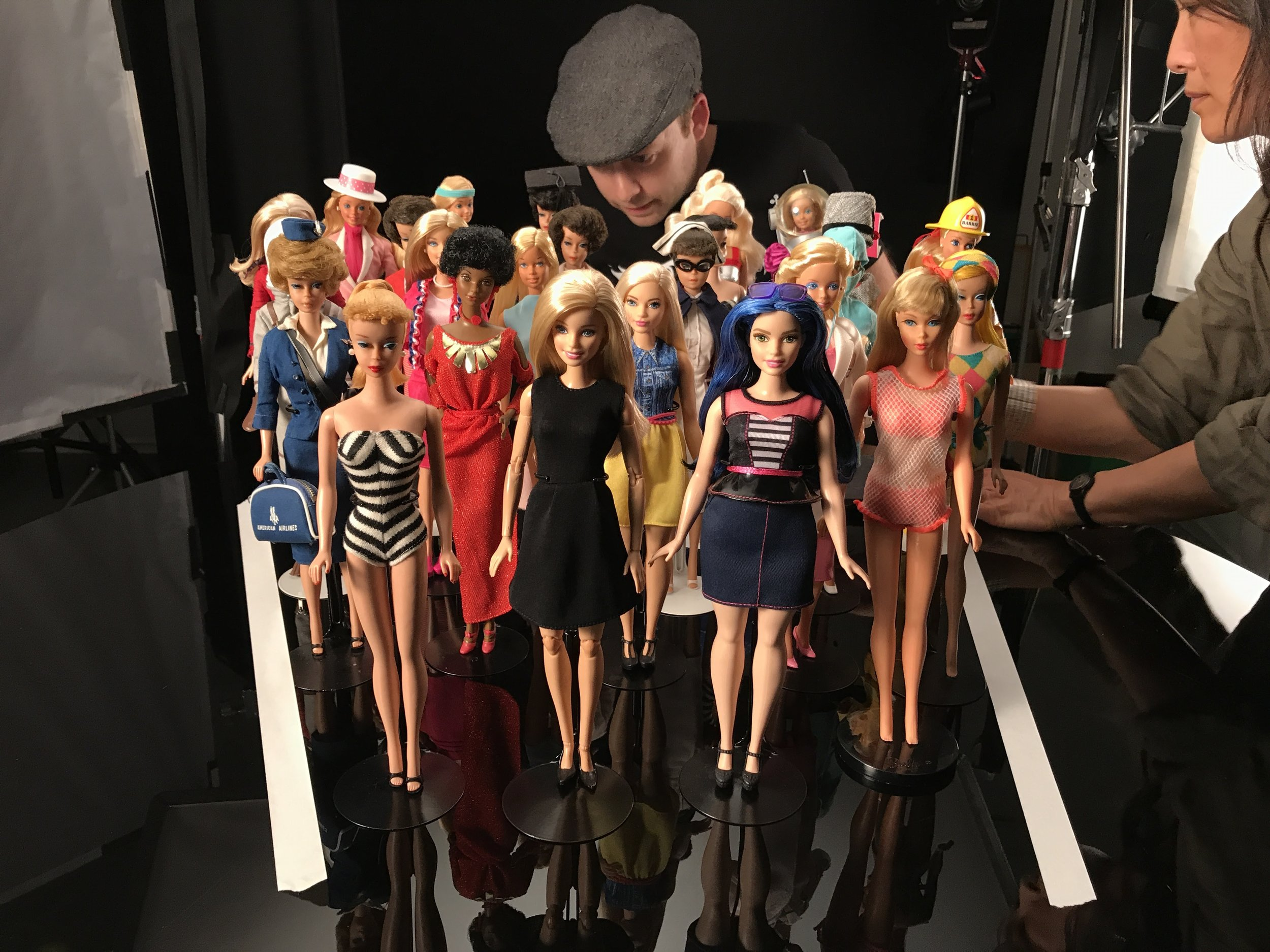 A collection of Barbie dolls from the original doll to the modern dolls.