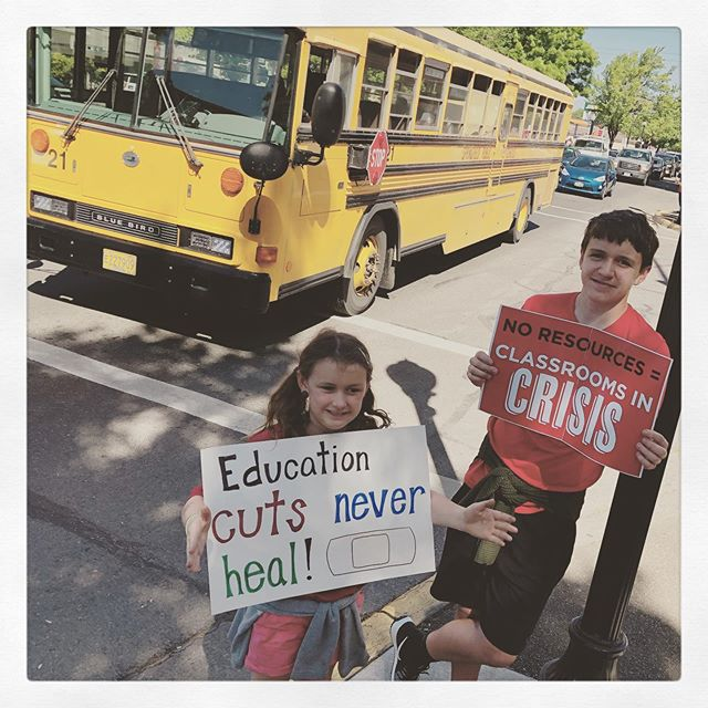 On the corner of 7th and Main with the kiddos as a bus rolled by. #Iamsps @springfieldps teachers, staff, parents, volunteers, administrators and students are lining the streets as far as you can see in both directions. #redfored #redforeducation #publiceducation #publiced #springfieldoregon
