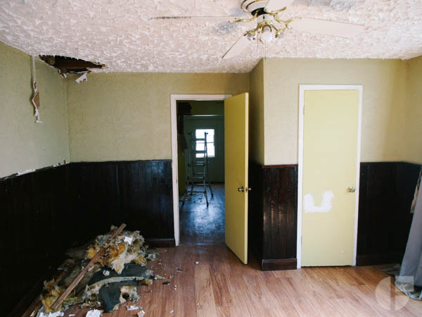 Original yellow on beige on brown color scheme. This was the living/bedroom on one side of the house.