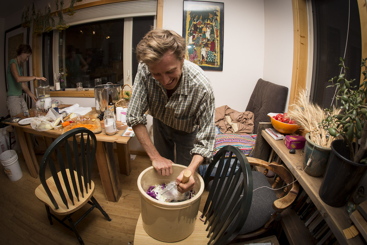 When food preservation gets serious, even the shop tools may find their way into the home kitchen:  Noah pounds cabbage for sauerkraut with the large mallet.  This will find its way into a shared neighbor meal soon, after weeks of fermenting in the corner by the bookshelf.
