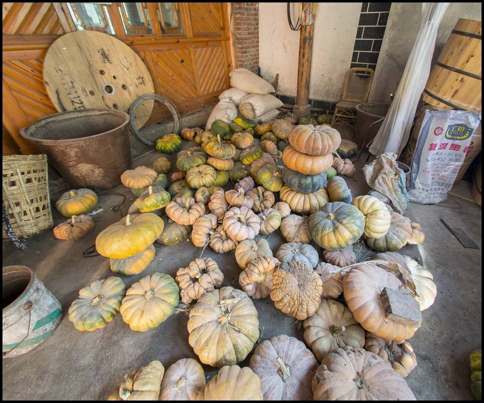 One a family's squash store rests in a small room inside a family compound.