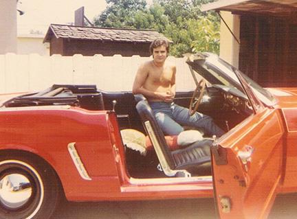 John Michael Roch in his red Mustang