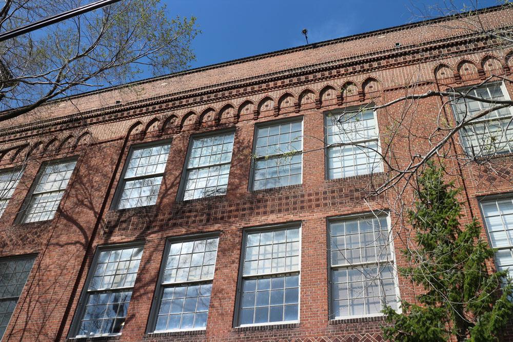 Exterior view of Condo #301. (Upper four windows.)
