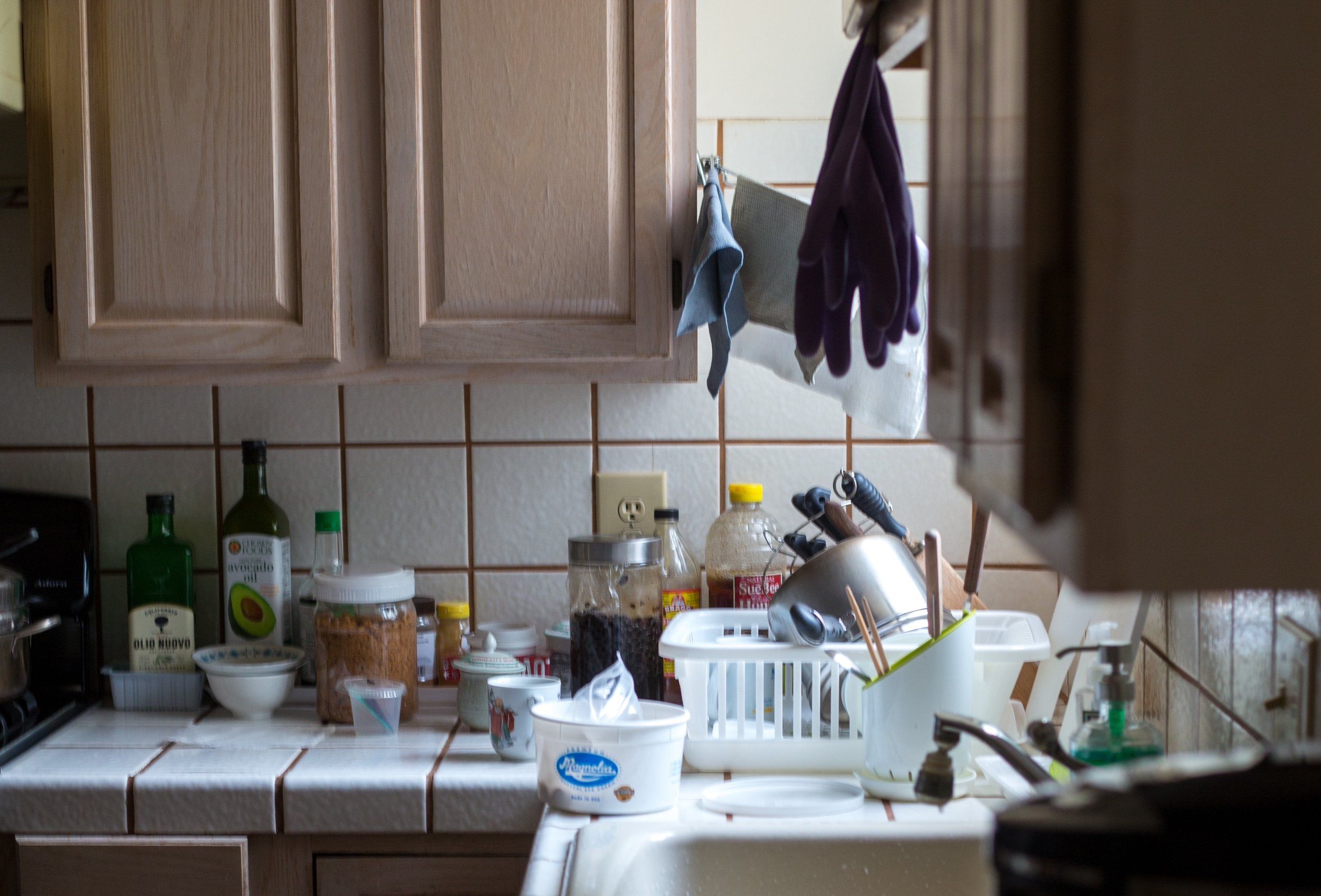 a messy kitchen that will need cleaning before selling