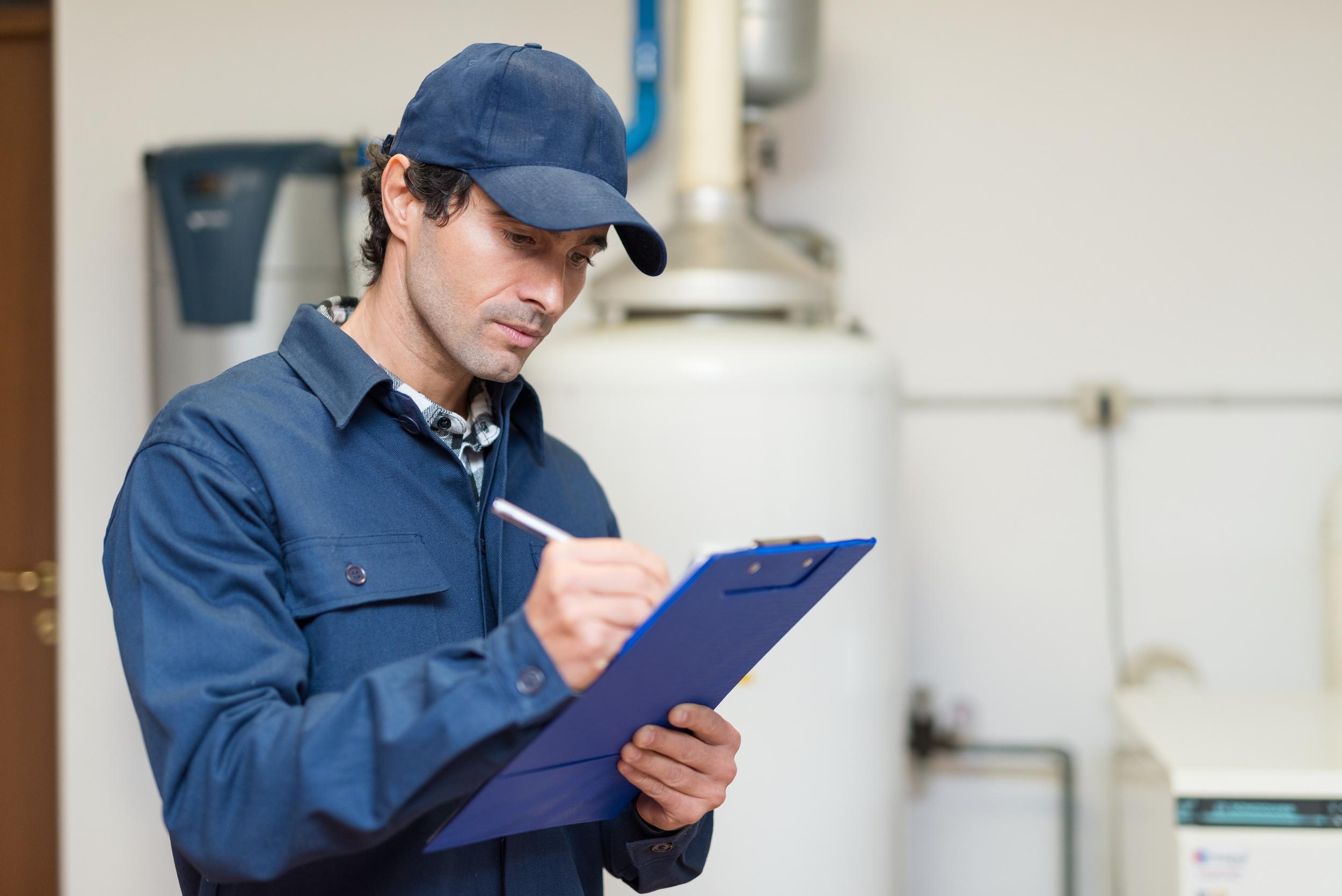technician checking for radon gas in a home