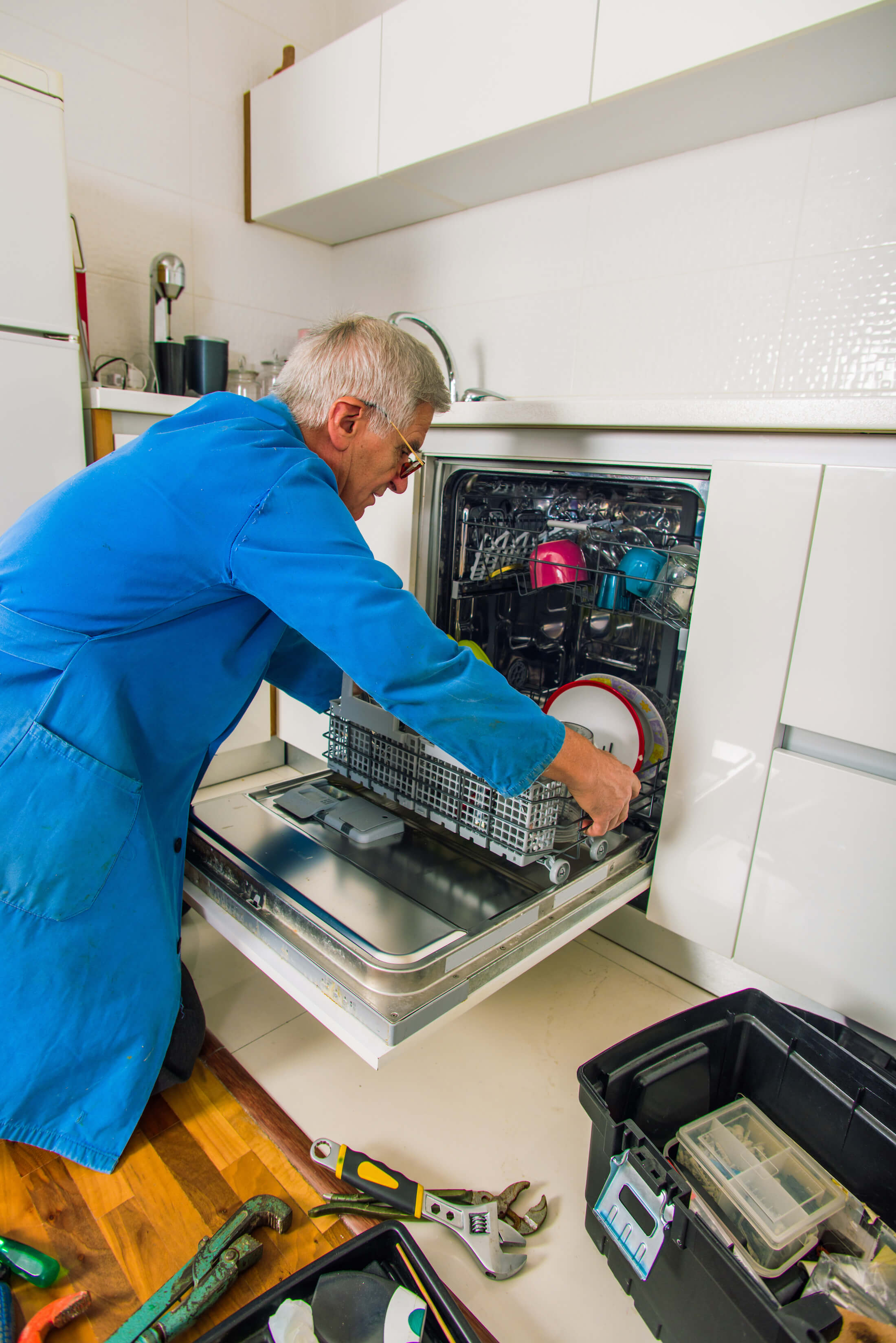 appliance technician assessing a dishwasher after it failed and stopped working