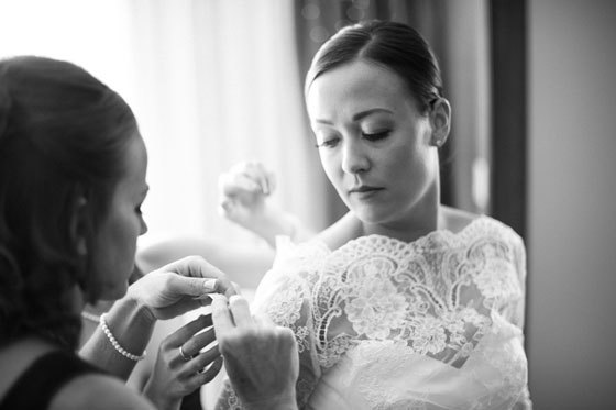 Bridesmaid helping the bride get ready - Jeff Sampson Photography