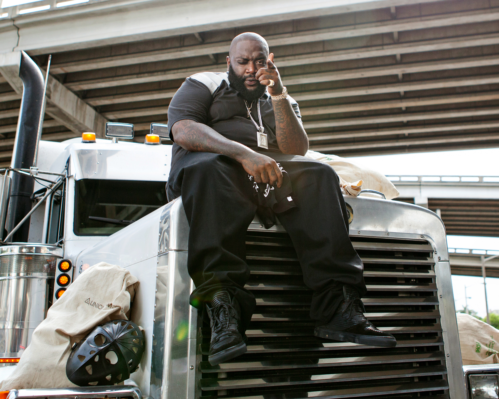 "Rick Ross on set of ""50 Plates"""