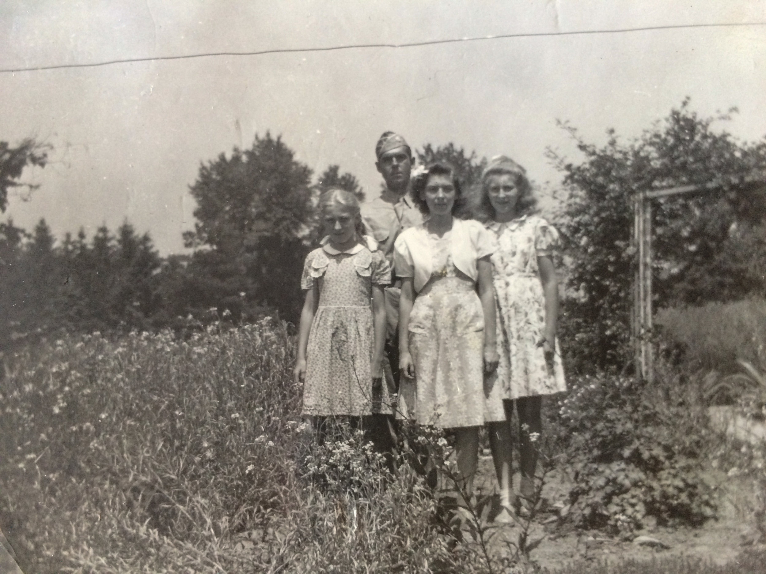 My dad, Roscoe W. Boward, with his younger sisters Rosie, Miriam, and Louise. The photo was most likely taken on one of his furloughs when he was stationed somewhere on the east coast soon after enlisting.
