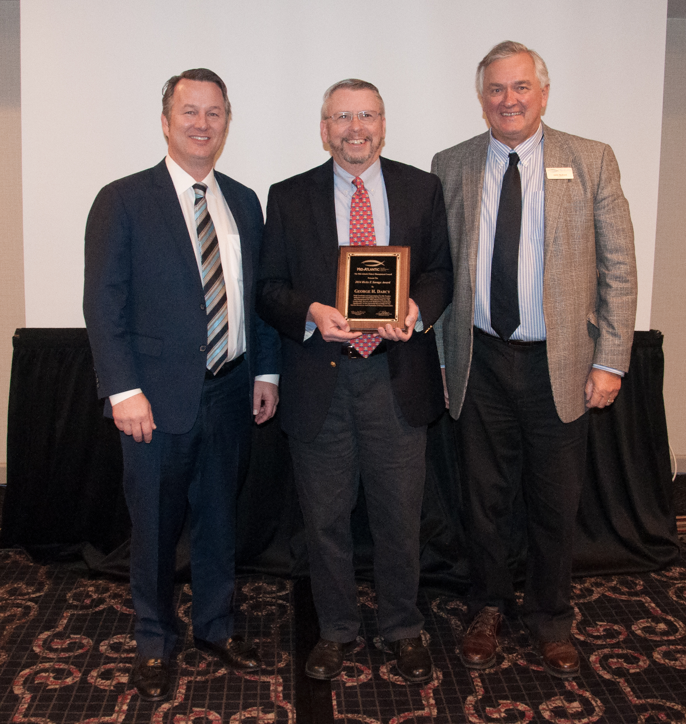 Ricks E Savage award recipient George Darcy (center) with Council Chairman Rick Robins (left) and Regional Administrator John Bullard (right).