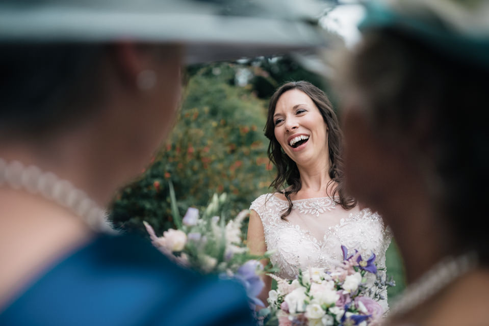 Beautiful Bride laughing at a wedding in Wiltshire