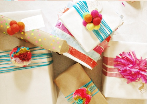 ETHICAL GIFT GUIDE: WRAPPING  Raid your craft stash for supplies like tissue paper, yarn, and garland for festive wrapping via  A Lovely Lark .