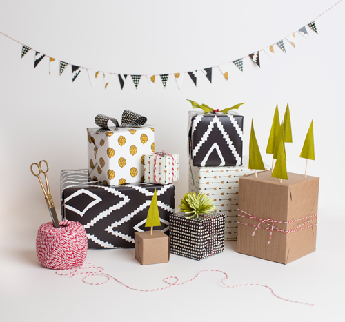 ETHICAL GIFT GUIDE: WRAPPING  Recycle paper into pretty gift toppers with these templates from The House That Lars Built .