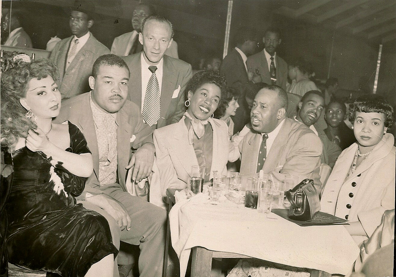 Left to right: Unidentified woman, Joe Louis, Norman Schlossberg, Sarah Vaughan, King Kolax, and unidentified woman.  Courtesy of the Schlossberg family via the  Crown Propeller's Blog .
