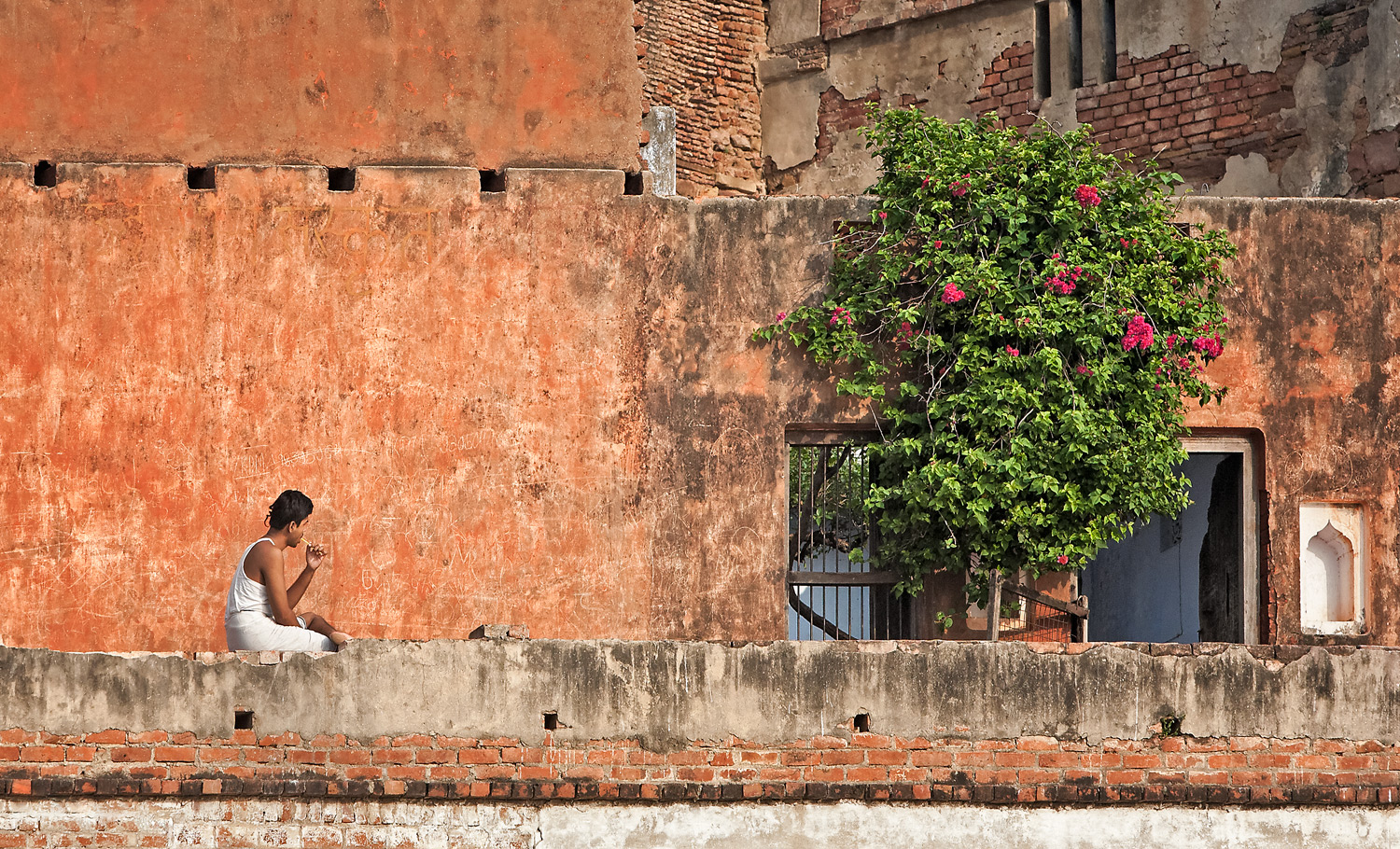 Man brushing teeth above the ghats, Varanasi, India