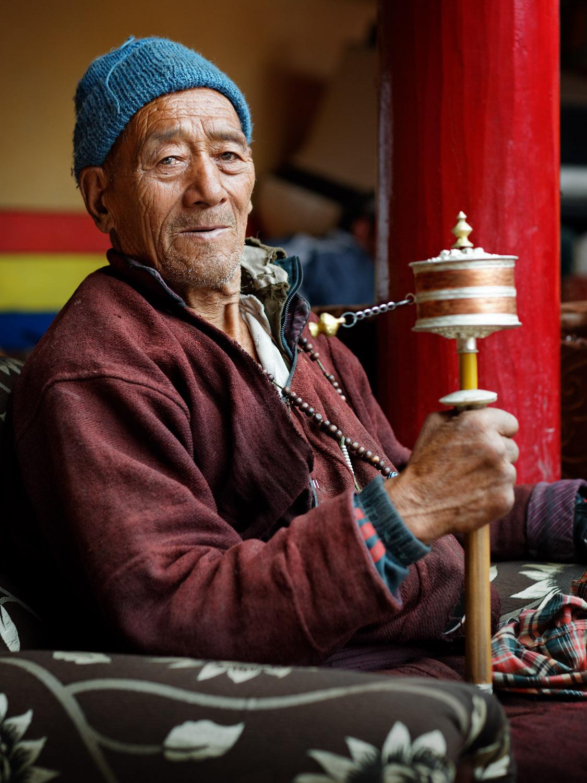 Man with prayer wheel, Hemis Monastery