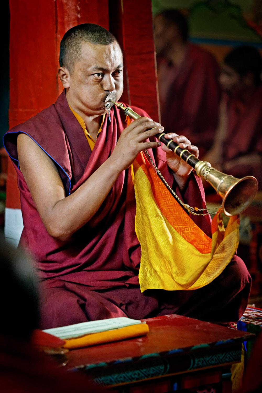 Monk blowing horn, Hemis Monastery