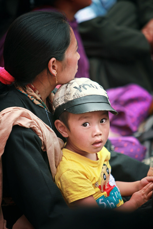 Mother & son listening to teaching, Hemis Monastery
